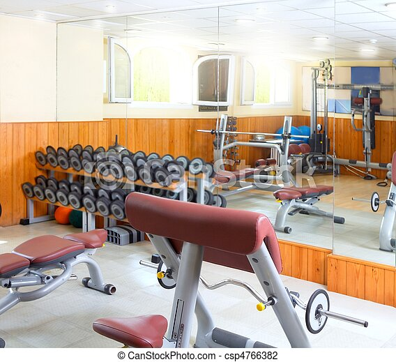 Gym interior bodybuliding weights exercise room - csp4766382