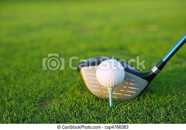 Golf tee ball club driver in green grass course - csp4766383