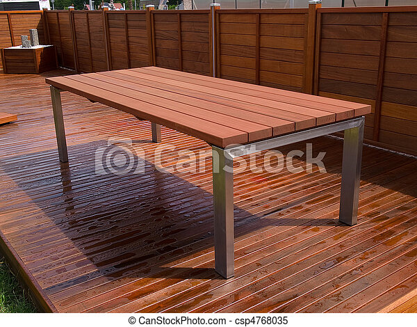 Beautiful mahogany hardwood deck floor and table - csp4768035