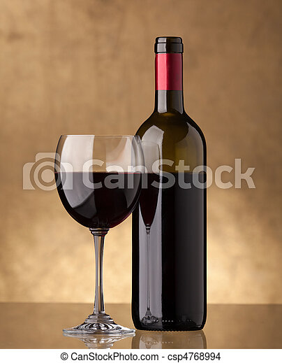 A bottle of red wine and filled a wine glass - csp4768994