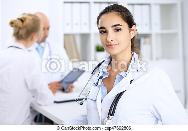 Happy doctor woman with medical staff at the hospital.
