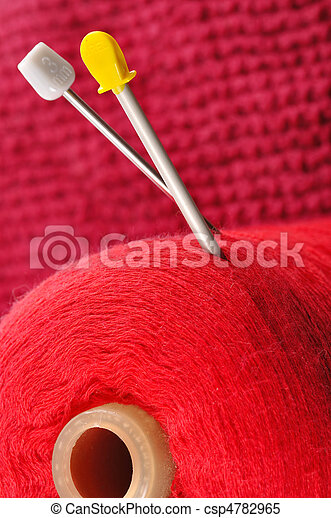 skein of thread and knitted fabric with spokes - csp4782965