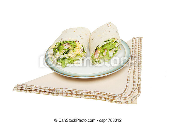 Bread wraps on a plate with a serviette - csp4783012