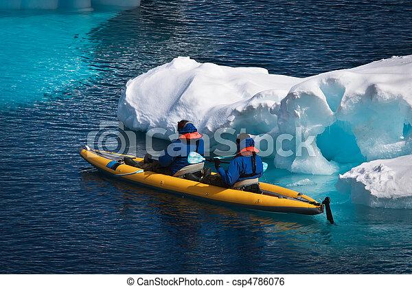 Two men in a canoe  - csp4786076