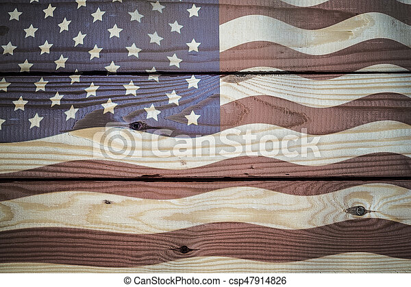 Vintage American Flag painted on aged, weathered rustic wooden Background.