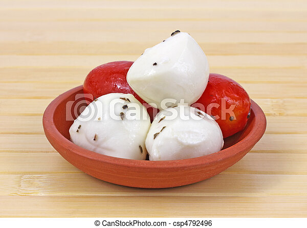 Marinated mozzarella balls and tomatoes - csp4792496