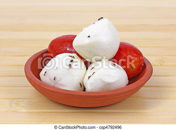 Marinated mozzarella balls and tomatoes - csp4792496