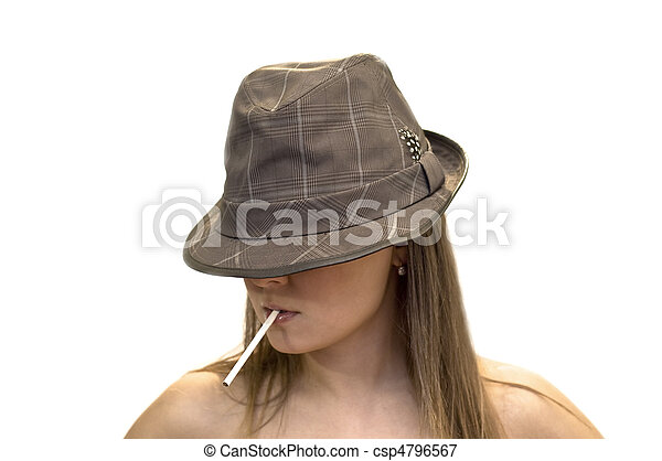 Young woman in a hat with a cigarette in his mouth. Close-up, studio shot, white background. - csp4796567