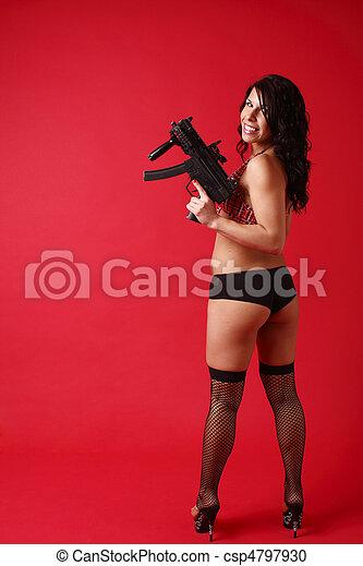 Sexy young woman with gun - csp4797930