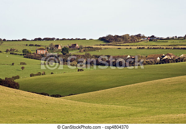Beautiful stormy landscape over agricultural English contryside - csp4804370