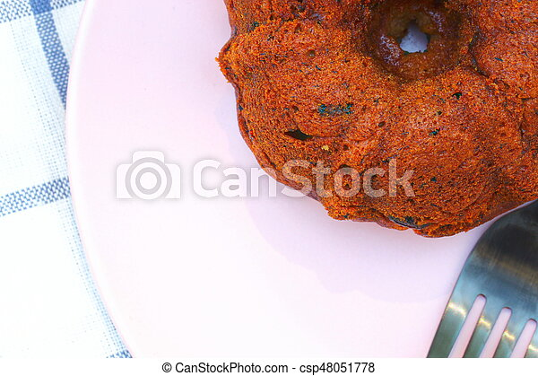Small banana bread Bundt cakes on a wooden background with copy space - csp48051778