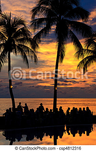 Diner on the beach at sunset