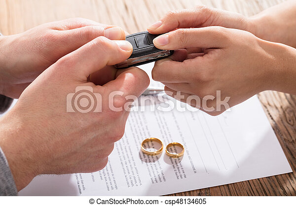 Couple\'s Fighting For Car While Signing Divorce Agreement With Gold Wedding Rings
