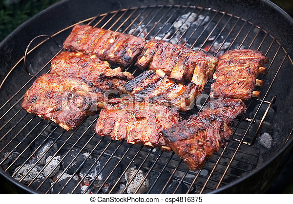 grilled pork ribs on bbq grill (shallow DOF) - csp4816375