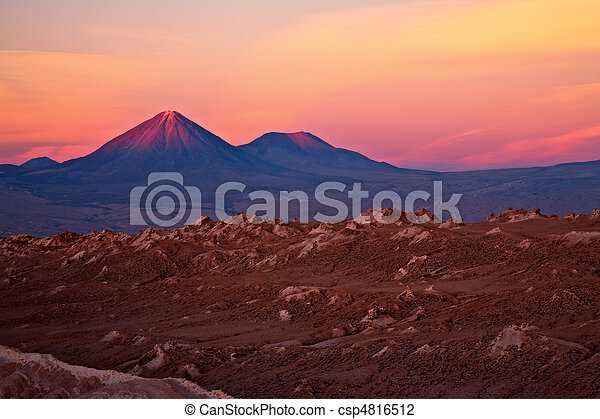 sunset over volcanoes Licancabur and Juriques, Atacama desert, Chile - csp4816512