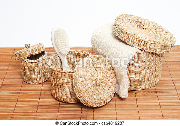 woven baskets with bath accessories - csp4819287