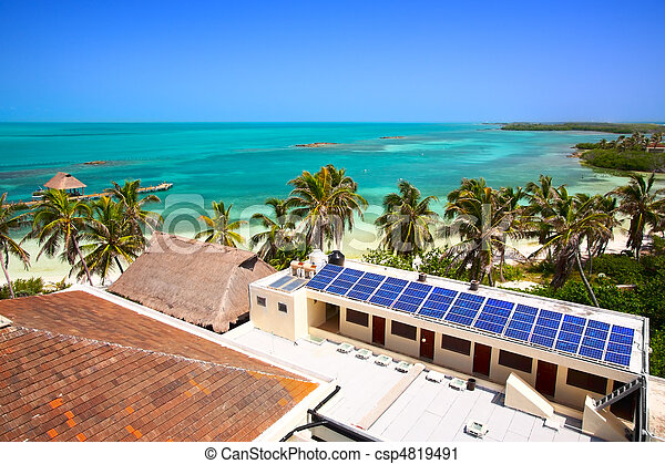 aerial view on the beach with a building with a solar panel on the Isla Contoy, Mexico - csp4819491