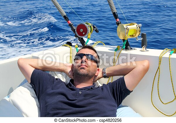 Sailor man fishing resting in boat summer vacation - csp4820256