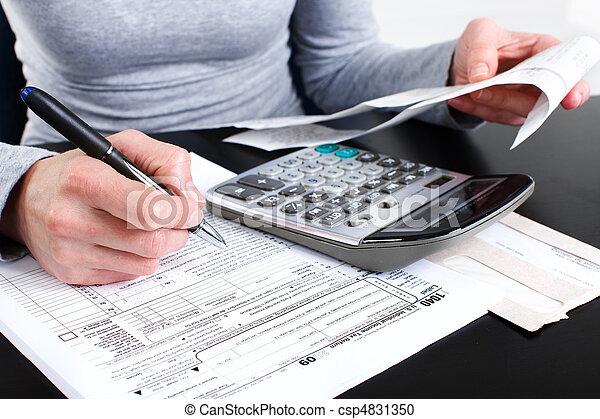 Stock Photography of Filling the Tax Form - Filling the Form 1040 Standard US...