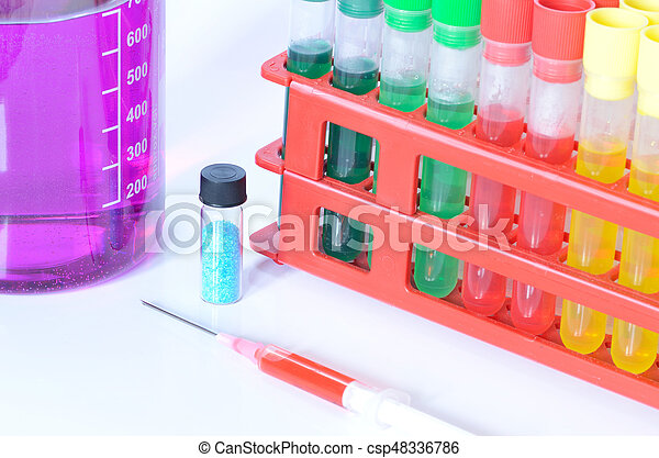 Set of chemical test tubes with different colors chemicals and chemical beaker with permanganate dissolved in water, pipette, bluestone and syringe