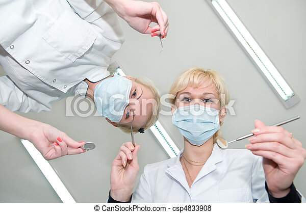 dentists preparing for dental curing - csp4833908
