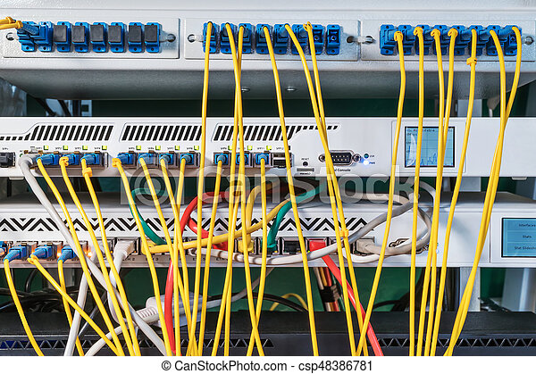 Rack with a lot of routers and wires connected to them