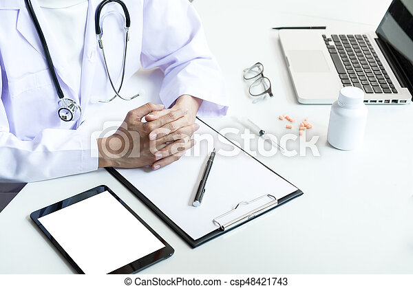 Health care and Medical concept, Female doctor hand hold on clipboard pad to recommend treat of patient.