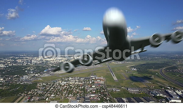 Aerial shot of commercial airplane leaving an international airport