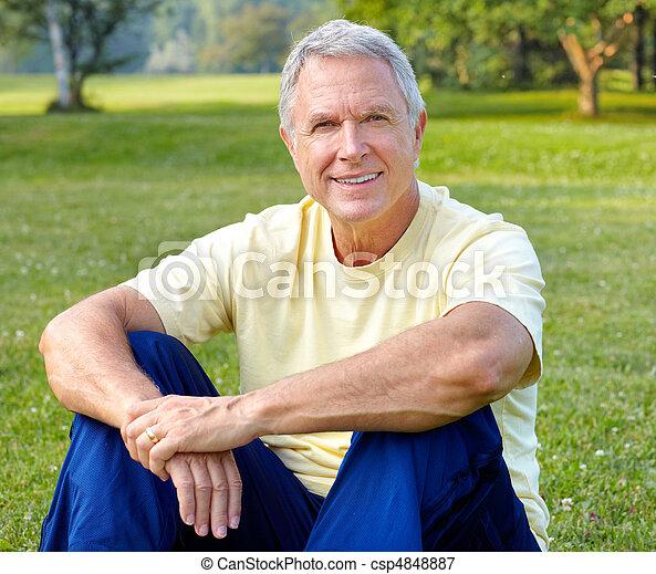 elderly man  in park - csp4848887