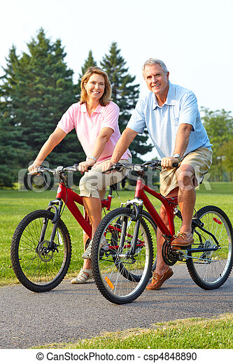 seniors couple biking - csp4848890