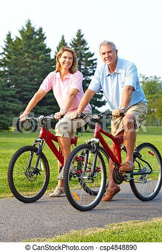 seniors couple biking - csp4848890