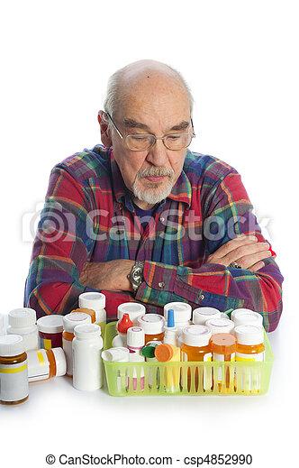 man with prescription bottles - csp4852990