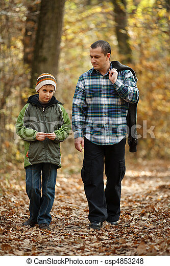 Father and son taking a walk outdoor - csp4853248