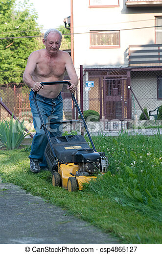 man cutting the grass with the mower - csp4865127
