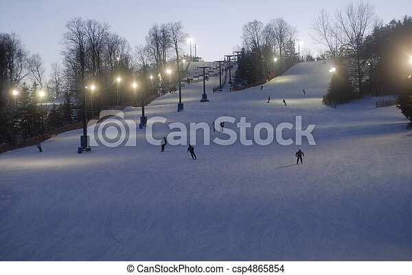 night time skiing and snowboarding at a small ski hill in south western Ontario - csp4865854