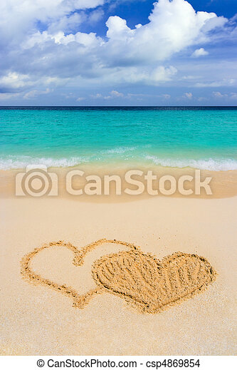 Drawing connected hearts on beach - csp4869854