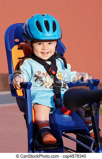 happy baby in bicycle chair - csp4878340