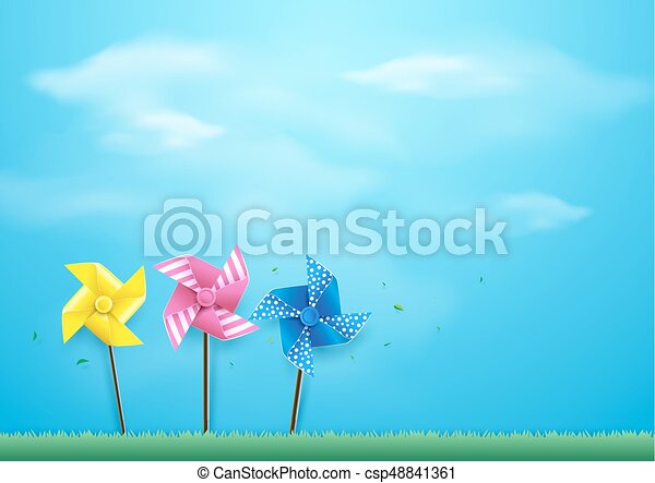Windmills blowing in the wind on blue sky. Paper art and craft style - csp48841361