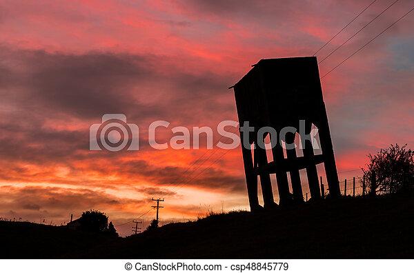 Water Tower Sunset - csp48845779