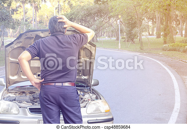 Young male on the road has problems with their car