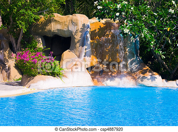 Pool and waterfall in hotel - csp4887920