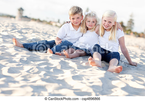 Adorable Sisters and Brother Having Fun at the Beach - csp4896866