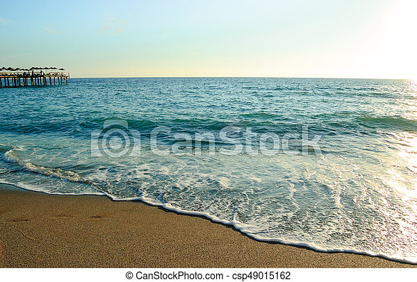 Beautiful Summer Seascape with Waves of Blue Sea and Sand Beach in Sun Light. Travel and Vacation Concept. - csp49015162