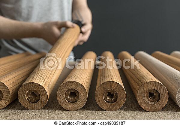 Man taking wooden billet - csp49033187