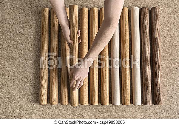 Man taking wooden billet - csp49033206