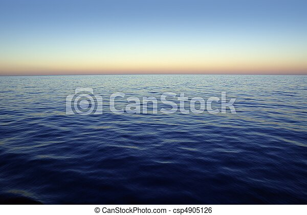 Beautiful sunset sunrise over blue sea ocean red  sky - csp4905126