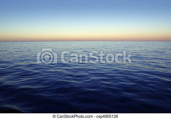 Beautiful sunset sunrise over blue sea ocean red  sky - csp4905126