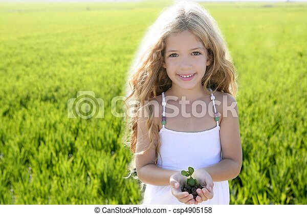 sprout plant growing from little girl hands outdoo - csp4905158