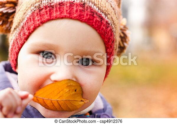 Beautiful baby portrait outdoor against autumn nature - csp4912376