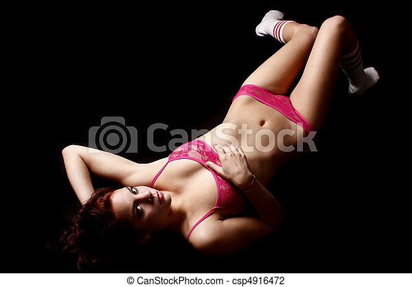Young woman wearing pink lingerie - csp4916472